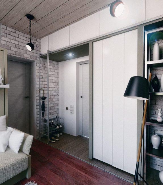 Apartmen reka bentuk dalam gaya moden. Kekurangan partition memberikan banyak cahaya semulajadi.