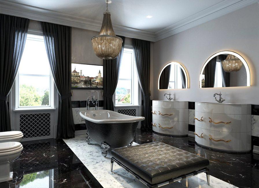 Dua cermin separa bulat menekankan gaya klasik bilik.
