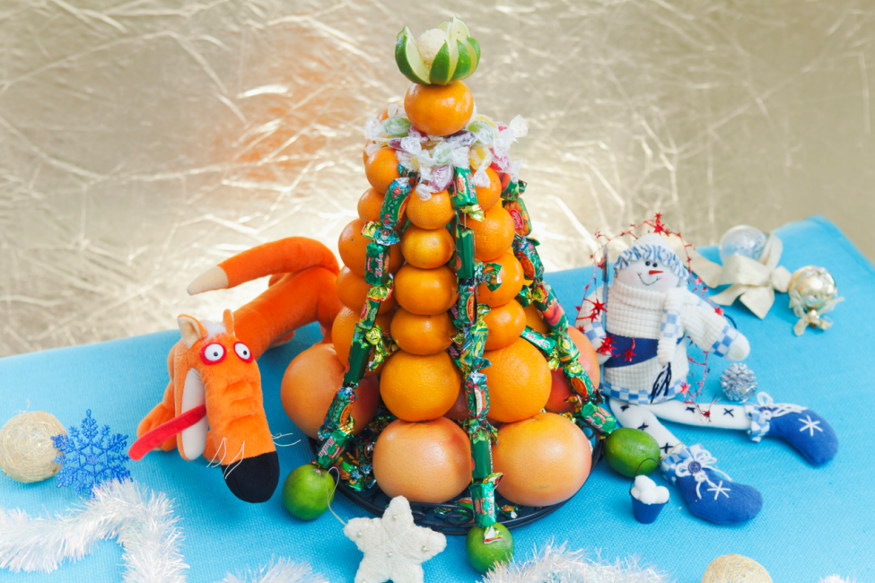 Designer Christmas tree of fruits and sweets
